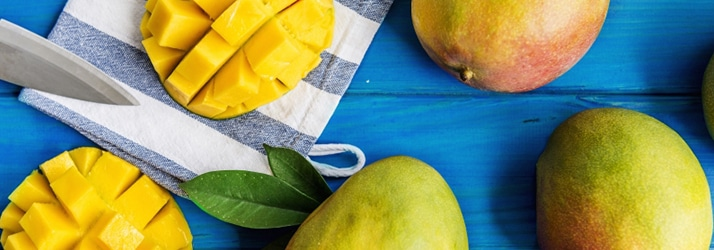 mangoes on blue table